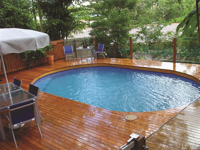 an above ground pool which has been fully decked in